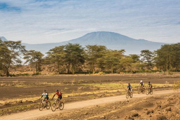 Riders enjoying the beautiful landscape around them.